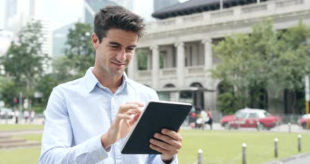 spaniard : Businessman use of tablet computer at outdoor Stock Footage