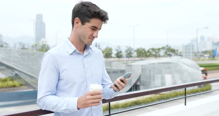 spaniard : Businessman hold with cellphone and coffee cup
