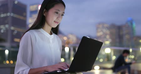 Woman work on notebook computer at night