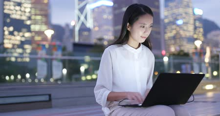 Businesswoman work on laptop computer at night