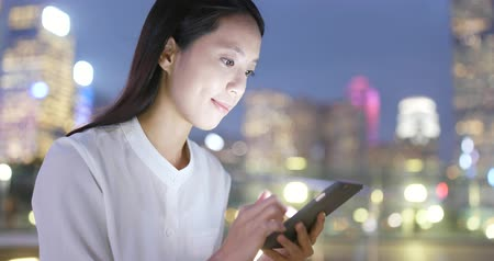 hong kong : Young Businesswoman work on cellphone at night