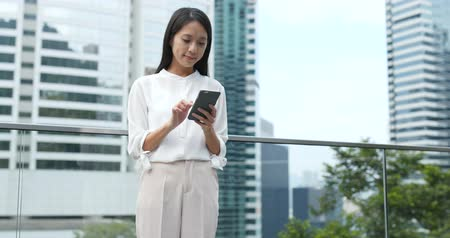 hong kong : Young Woman use of smart phone in city