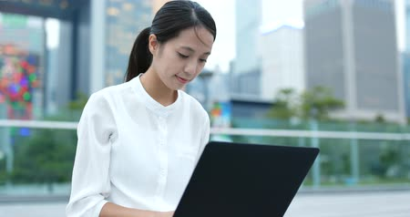 use laptop : Asian Woman work on laptop computer Stock Footage