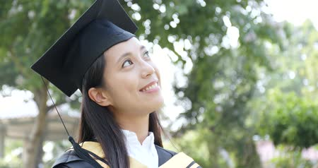Asian Woman get graduation and think of future