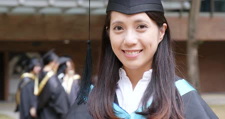 Woman get graduation in university campus
