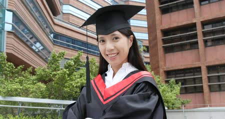 Confident woman graduated in university