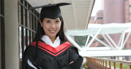 Asian woman graduation in university campus