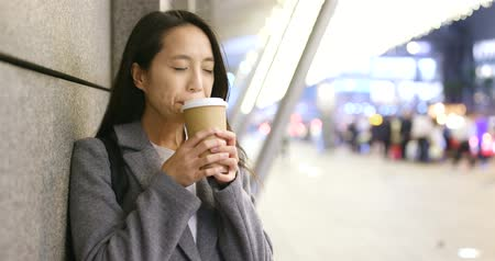hong kong : Woman feeling cold and drink of coffee