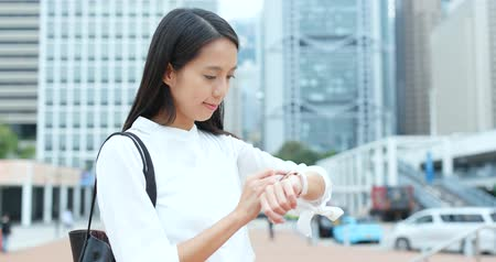 Businesswoman use of smart watch