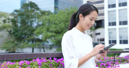 use laptop : Woman use of cellphone at outdoor Stock Footage