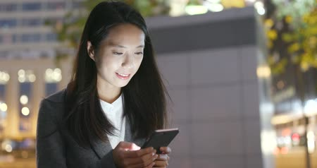 Young Business woman use of smart phone at night