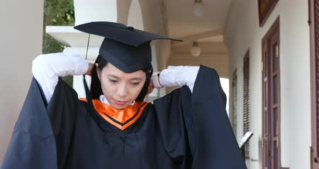 Woman wearing graduation gown