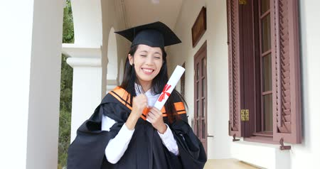 Excited woman get graduation in university campus