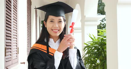 mezun : Woman hold with certificate with graduation gown