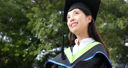 mezun : Young successful woman graduation and think of future Stok Video