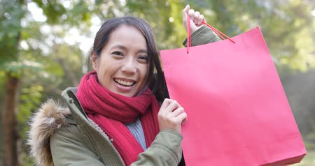 Happy woman holding a red shopping bag Dostupné videozáznamy