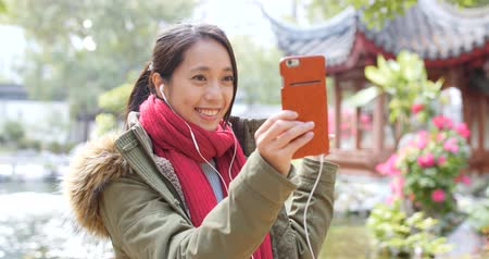 lunar : Woman making video call on smart phone in china Stock Footage
