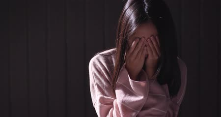 temper : Depressed woman crying alone in the dark Stock Footage
