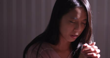 holy scripture : Woman pray for the god Stock Footage