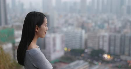 hong kong : Young Woman looking in the city Stock Footage