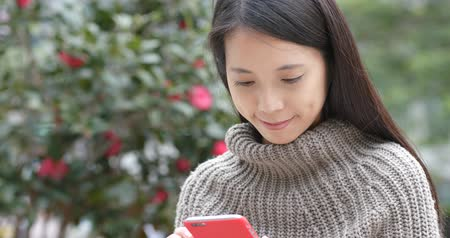 sms : Woman use of mobile phone at outdoor Stock Footage