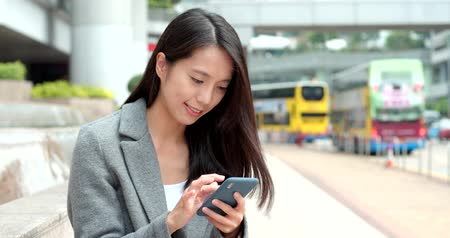typ : Business woman use of smart phone in city