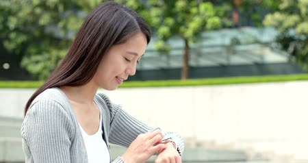 central business district : Woman use of smart watching at outdoor street