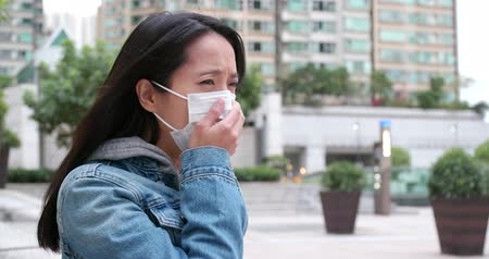 infectious : Woman coughing and feeling sick with wearing face mask