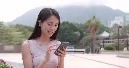 sending : Woman using smart phone at outdoor