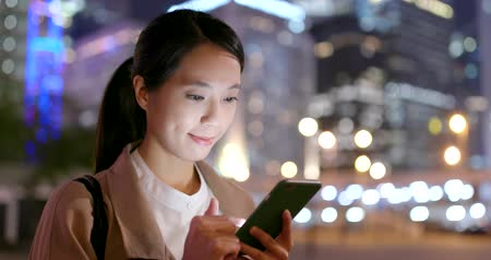status : Business woman use of mobile phone in city at night Stock Footage