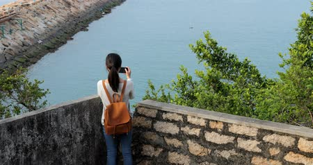 pont : Woman taking photo with the sea
