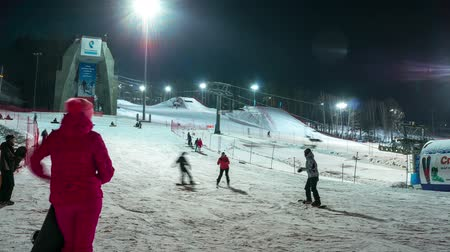 ski run : people learn to snowboard in ski resort bobrovy log, Krasnoyarsk, time lapse