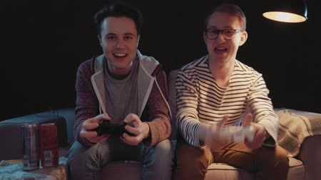 playstation : Two gamers in front of the screen are cutting in the online battle
