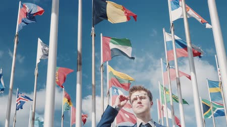 görüş uzaklığı : Optimistic look into a promising future Conceptual clip against the background of clear sky and national flags of different countries