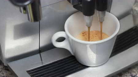 ristretto : An automatic coffee maker prepares a coffee drink and pours it into a cup. Stock Footage