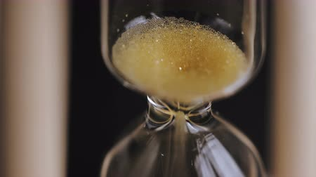 significar : sand in an hourglass macro video Stock Footage