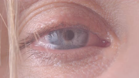 the female eye cries and tears are flowing macro video