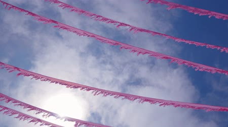 spanish style : festive garland and tinsel against the blue sky