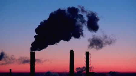 climate : Smoking stacks, sunrise, time-lapse Stock Footage