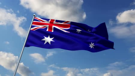ausztrál : Australian flag waving against time-lapse clouds background Stock mozgókép