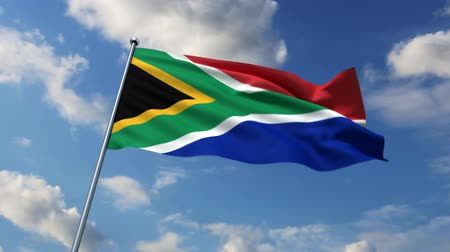 délre : South African flag waving against time-lapse clouds background Stock mozgókép