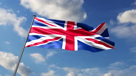 büyük britanya : British flag waving against time-lapse clouds background Stok Video