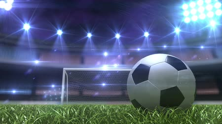 atividades : Football background, soccer ball on the grass at night stadium. 3d animation Stock Footage