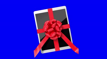 fitas : Tablet pc with a red ribbon on a blue screen. 3d animation Vídeos