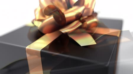подарок : Unpacking a Gift. beautiful 3d animation with a depth of field. Full HD version with a black gift. See more animations with presents in my portfolio Стоковые видеозаписи