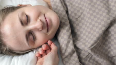 wakeup : Girl wakes up and smiles