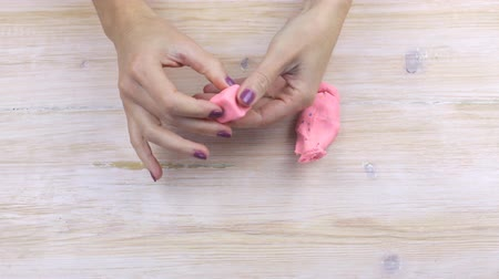 пластилин : Hands mold plasticine geometric shapes