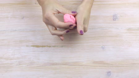 пластилин : Hands squeeze plasticine, relieving stress
