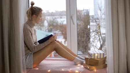 contemplative : Girl is reading a book and sitting