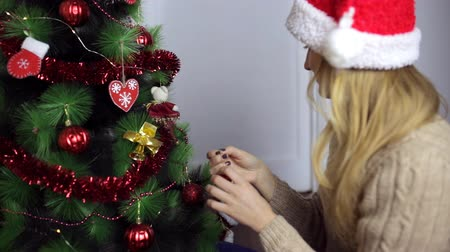 Girl in a sweater and Santas cap Stockvideo